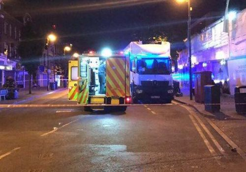 Man fights for life after four stabbed outside London train station