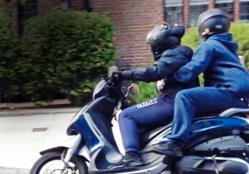 Moped thugs threaten baby with huge knife during terrifying street robbery
