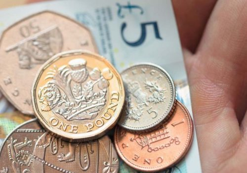Pound slips lower as May faces leadership pressure