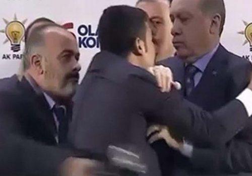 Erdoğan 'hug' stirs security debate