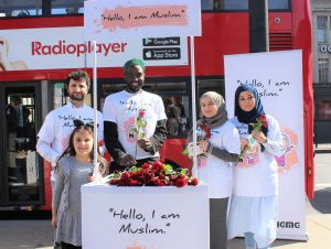 Muslim's hand out roses against violence in London