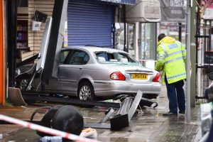 Car crashes into North London shop