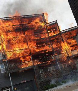 Blazing fire engulfs a block of flats
