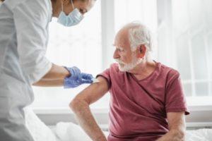 Half of UK population offered flu jab this year
