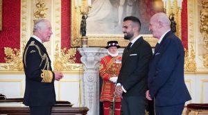 Mete Coban receives his MBE award