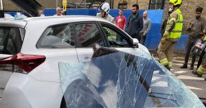 Five people hospitalized after car smashes into barbers